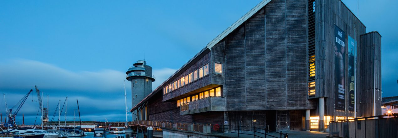 The National Maritime Museum Cornwall at dusk overlooking Falmouth harbour credit Luke Hayes