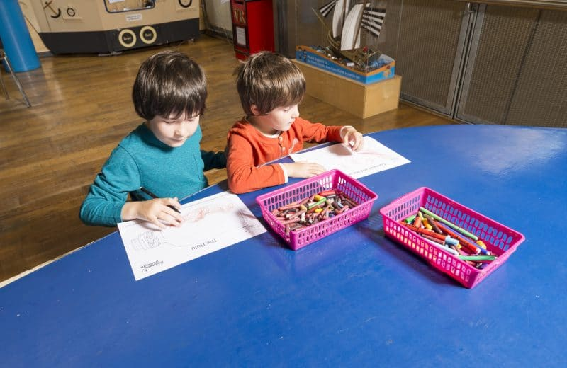 Alfie and Noah drawing and craftmaking at The National Maritime Museum Cornwall in Falmouth