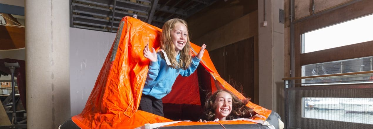Alfie and Noah on the Liferaft at The National Maritime Museum Cornwall in Falmouth